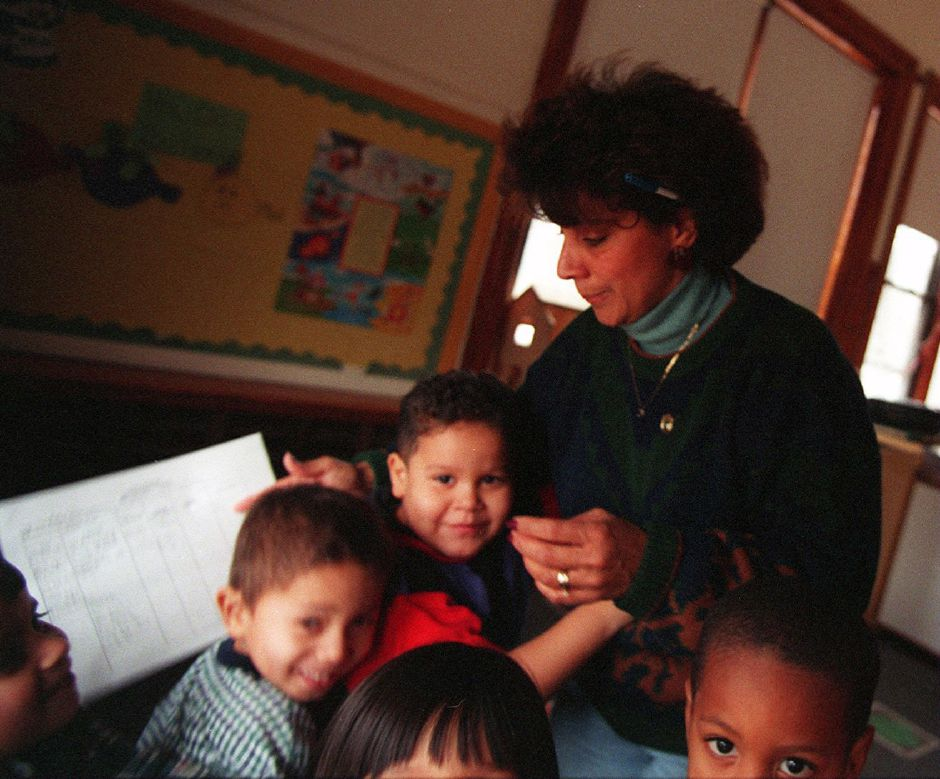 RJ file photo - Charlotte Warmsley of Meriden gets a warm welcome from children at the Meriden Head Start program, Jan. 1999.