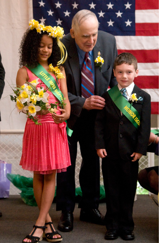 Meriden Deputy Mayor Matthew Dominello (center) congratulates the 2012 Honor Escort Thomas Sullivan (right),7, a first grader at Hanover School, as he stands alongside the 2012 Little Miss Daffodil Taylor Merritt (left) at the awarding ceremony at Hubbard Park in Meriden, April 25, 2012. (Sarah Nathan/Record-Journal)