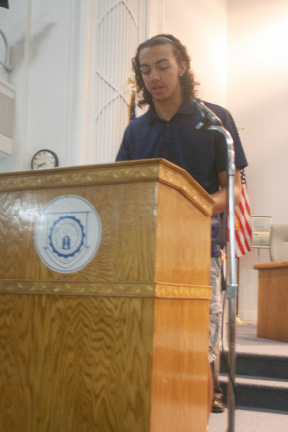 Lyman Hall High School senior Kyle Bonet speaks at the 9/11 ceremony in Wallingford. | Lauren Takores, Special to the Record-Journal