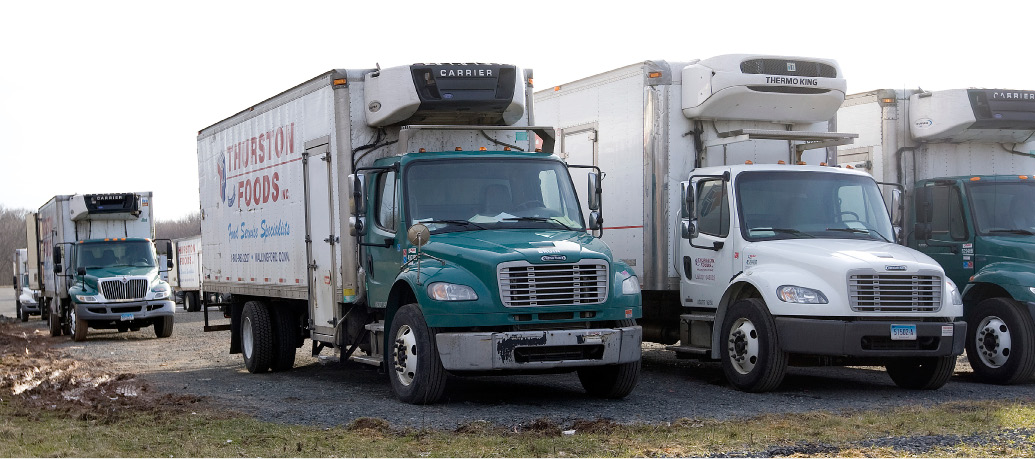 Thurston Foods trucks parked on the north end of the business in Wallingford, Friday, March 4, 2016.  |  Dave Zajac / Record-Journal