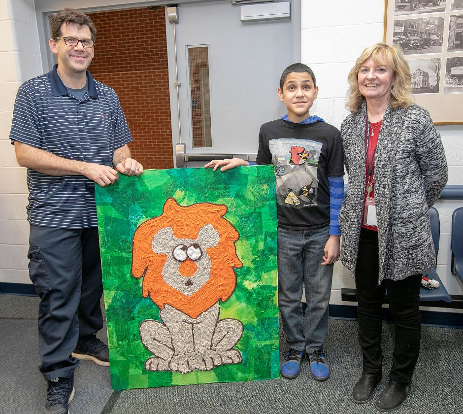 Sixth-grade student Jose Nieves Roman, 12, with art teacher, Justin Piccirillo, and tutor Maureen McCarver, shows his art project of a lion made from mixed media at Lincoln Middle School in Meriden, Tues., Jan. 8, 2019. Roman used yarn of different textures in creating the project over a two-month period. Dave Zajac, Record-Journal
