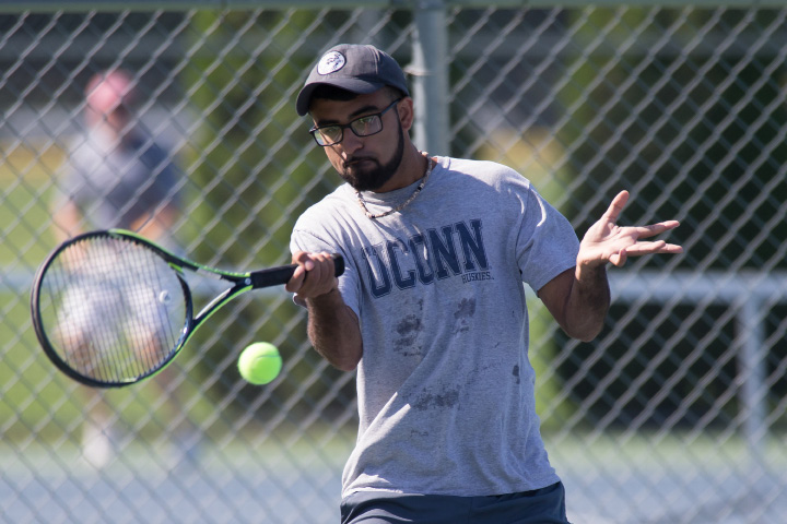 Kunal Kataria of Southington plays a volley in the A doubles match Sunday during the Wayton Open Tennis finals at Southington High School in Southington Jul. 16, 2017 | Justin Weekes / For the Record-Journal