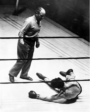 Boxer Jack Doyle slumped on the floor after the third and last knockdown at the hands of Buddy Baer in Madison Square Garden, New York on August 29, 1935. The referee Bill Cavanaugh decided he had taken enough punishment and stopped the fight before the first round was over. (AP Photo)