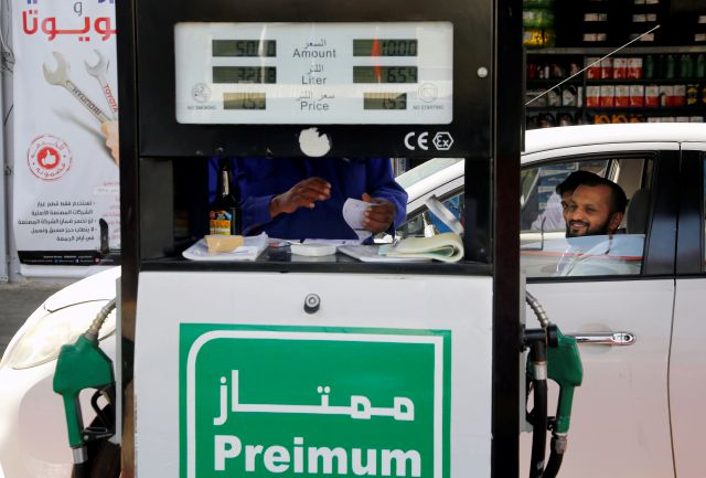 "A worker writes a receipt at a gas station in Jiddah, Saudi Arabia, Monday, Sept. 16, 2019. Global energy prices spiked on Monday after a weekend attack on key oil facilities in Saudi Arabia caused the worst disruption to world supplies on record, an assault for which President Donald Trump warned that the U.S. was ""locked and loaded"" to respond. (AP Photo/Amr Nabil)"