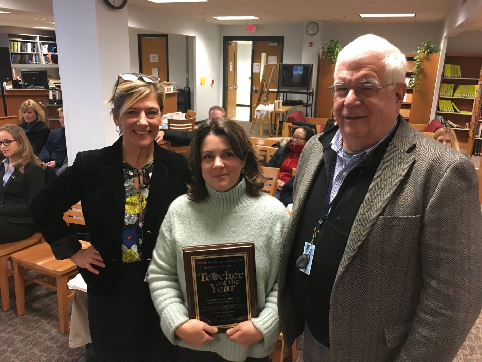 Regional School District 13 Superintendent Kathryn Veronesi, left, and Board of Education chairman Robert Moore pose with Teacher of the Year Deborah Mariani, literacy coach at Memorial Middle School, at school board meeting on Wednesday, Dec. 13, 2017. | Lauren Takores, Record-Journal