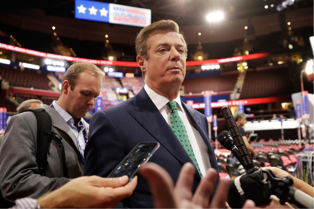 FILE - In this July 17, 2016, file photo, Paul Manafort talks to reporters on the floor of the Republican National Convention at Quicken Loans Arena in Cleveland. Manafort, President Donald Trump