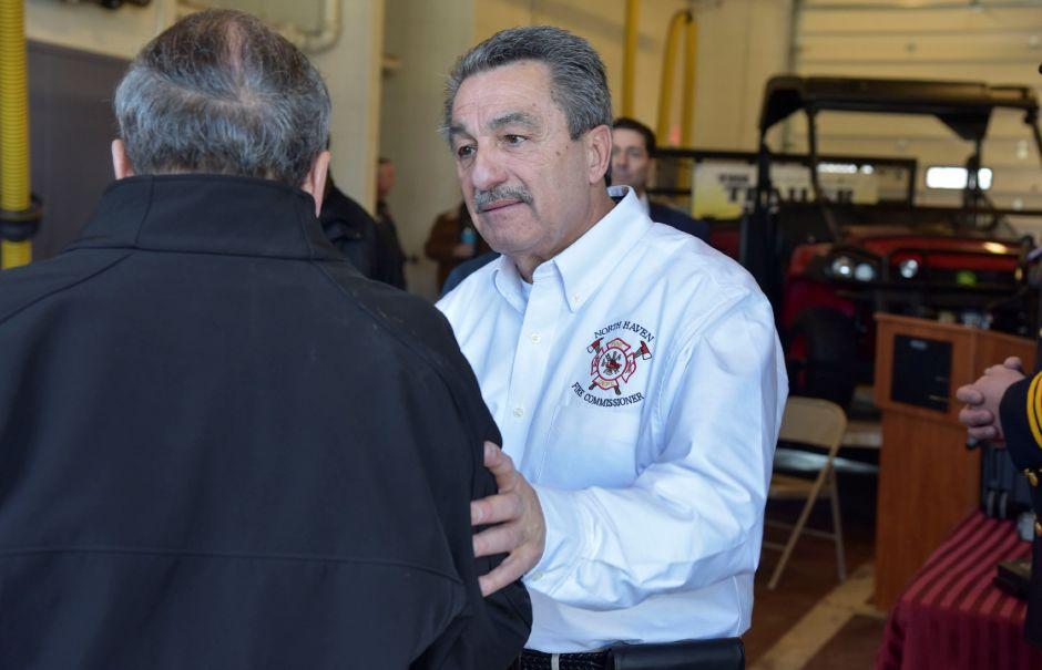 North Haven Board of Fire Commissioners member Peter Criscuolo shakes hands with First Selectman Michael Freda at a ceremony to thank donors at the firehouse on Jan. 31. Criscuolo led the fundraising effort, raising more than $40,000 for a drone, ATV and trailer. | Bailey Wright, The Citizen