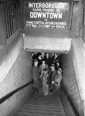 "New Yorkers, caught in a surprise air raid warning alert seek shelter in stores and subways. A crowd waits for the ""all clear"" in a subway station at Lexington Avenue and 51st street, Oct. 22, 1942. (AP Photo)"
