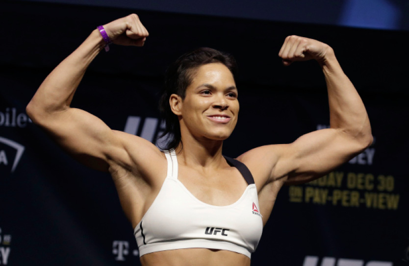 Amanda Nunes poses for photographers during an event for UFC 207, Thursday, Dec. 29, 2016, in Las Vegas. Nunes is scheduled to fight Ronda Rousey in a mixed martial arts women