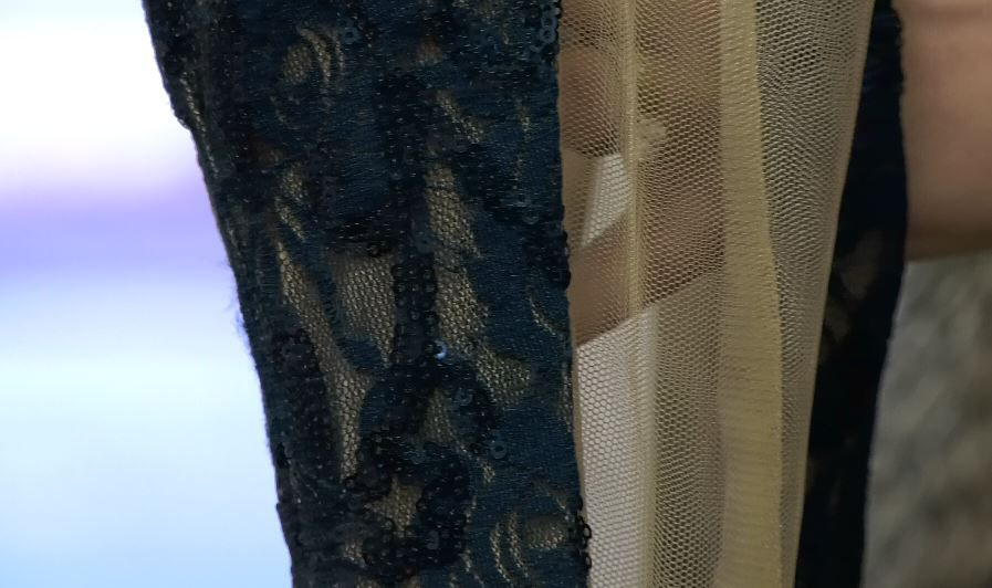 Mesh and lace detail on a dress at Dynamite Designs by Kristen, 1157 N. Colony Rd. |Ashley Kus, Record-Journal