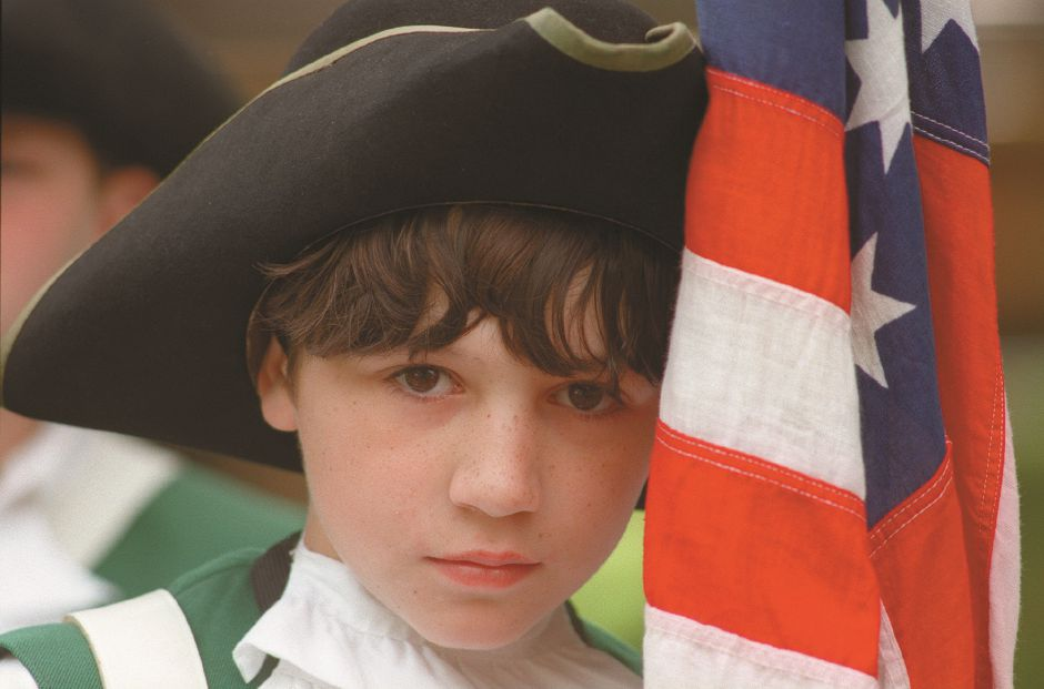 RJ file photo - Ten-year-old Freddy Ortega marches in the Wallingford Memorial Day parade with the First Fall Jr. Ancient Fife and Drum Corps of Yalesville. May 1998.