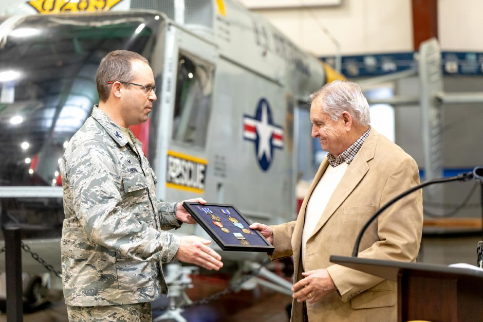 Colonel Stephen Gwinn, left,, commander of the 103rd Airlift Wing, presents Korean War veteran Robert Rawlings, of Berlin, with replacement service medals. The ceremony was held at the New England Air Museum in East Granby on Nov. 27, 2018, the medals included the Distinguished Flying Cross and Air Medal. | Devin Leith-Yessian/Berlin Citizen