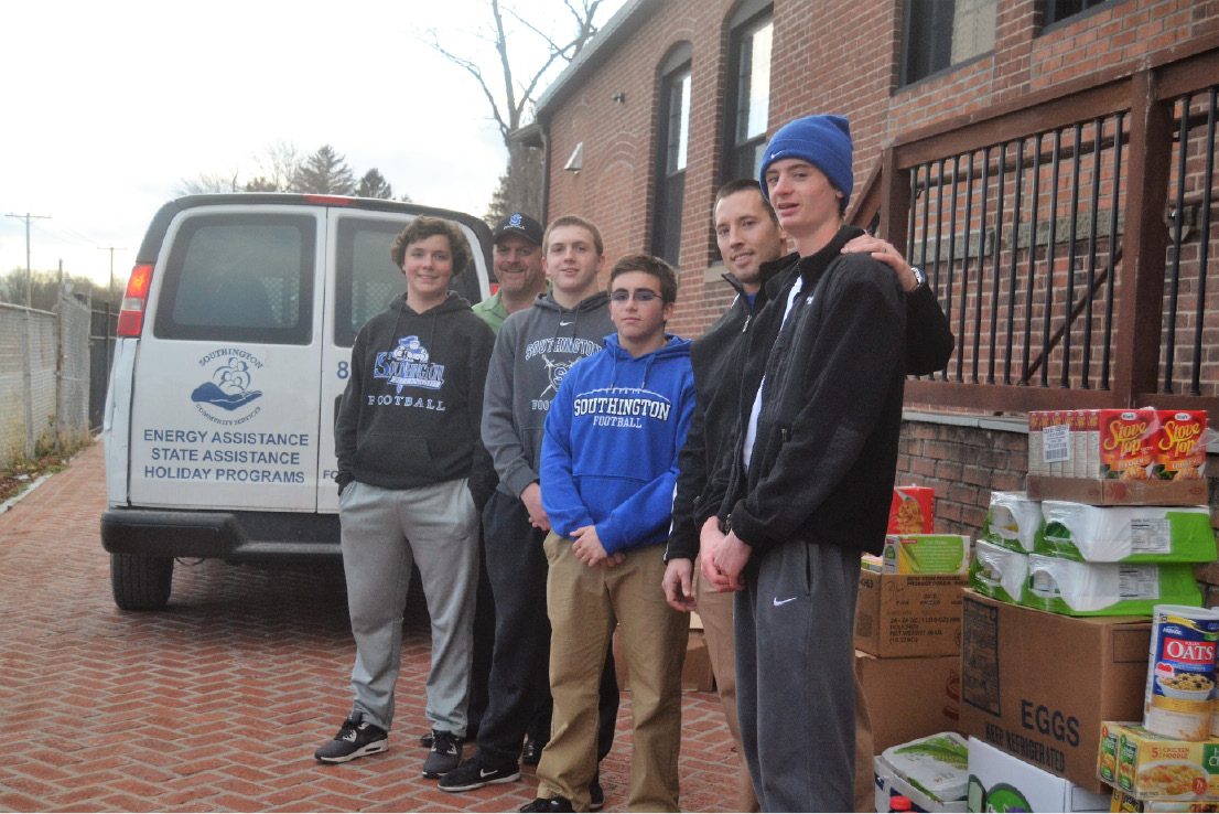 From the right Southington football player Sam Thompson, head coach Mike Drury, player John Aligata, Ian Hall, Guaranteed Rate regional manager and assistant coach Jim Earl and player Max Noonan poses with the over 2,500 pounds of food they collected for the Southington Community Services Center. | Pete Paguaga, Record-Journal