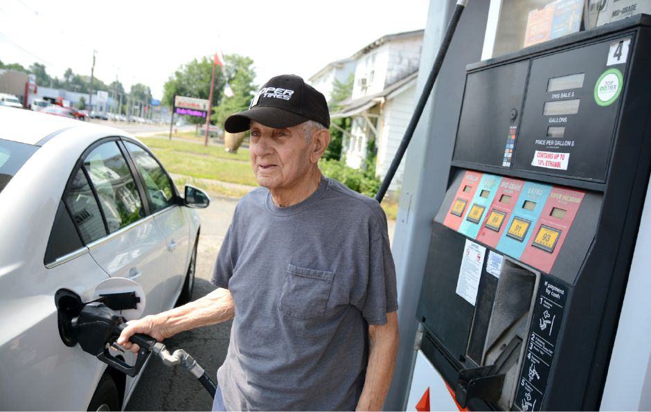 Ray Porto, owner of Citgo, 480 N. Colony Road, pumps gas at the station on Wednesday, Aug. 2, 2016. Porto has been working at the station for about 70 years. | Bryan Lipiner, Record-Journal