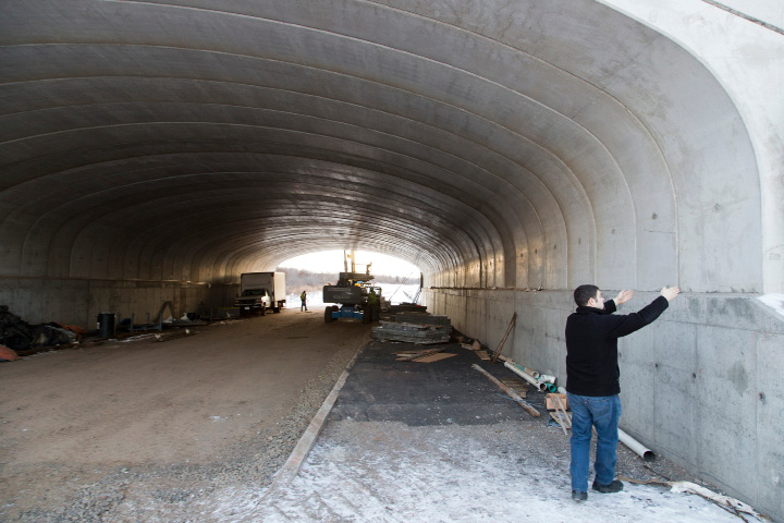 Joe Richello, a manager at United Concrete Products, points out the sections of precast concrete arches put together under Route 175 in Newington to create a 48-foot-wide tunnel. United Concrete Products, of Wallingford, supplied about $8 million worth of precast concrete products to contractors working on the Fastrack busway project. | Christopher Zajac / Record-Journal