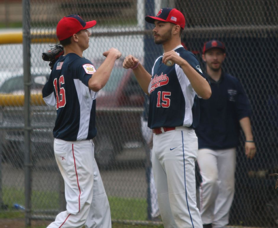 Jason Krar, right, gives some support to fellow Southington pitcher Ryan Henderson during a recent American Legion baseball game. Krar, who just graduated Southington High, is heading to the U.S. Amry in September.