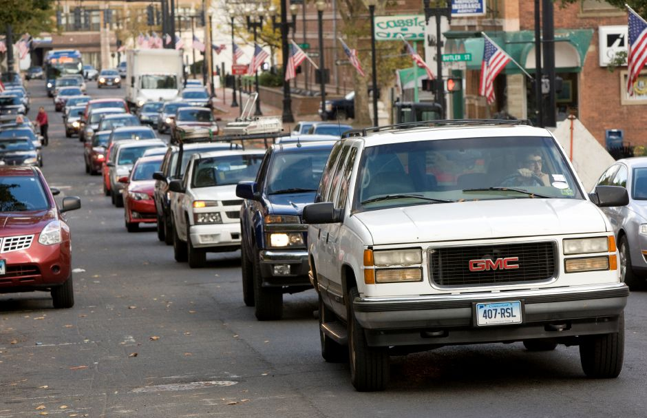 Traffic slows on West Main Street due to several areas of construction in downtown Meriden, Tuesday afternoon, October 14, 2014. The state began paving Cook Avenue Tuesday morning. In addition to the paving work, the intersection of Cook Avenue and West Main Street has been cluttered by the city's work to replace bump-outs. | Dave Zajac / Record-Journal