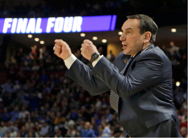 Duke head coach Mike Krzyzewski shouts at his team during the first half in a second-round game against South Carolina in the NCAA men