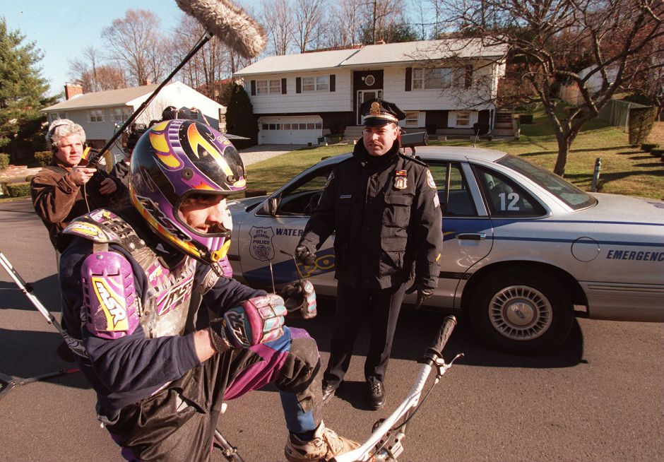 RJ file photo - Robin Jurglewicz demonstrates his bike surfing method to Sgt. Michael Edwards of the Waterbury Police Department, Dec. 14, 1998.
