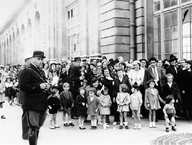 The children of Paris were led to three centers in the city on August 30, 1939, to receive gas masks on the eve of Germany's invasion of Poland. The children shown above are at the station where sizes are available for age three to ten. (AP Photo)