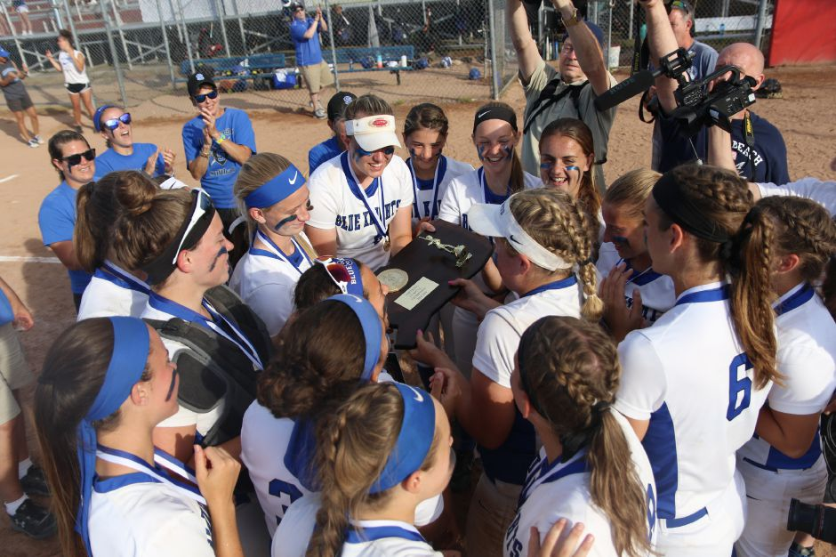 The Lady Blue Knights huddle around the Class LL State Championship after their 7-6 victory over NFA. | Spencer Davis, Record Journal