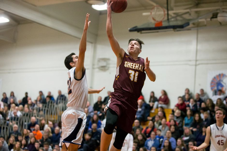 Sheehan's Garrett Molampy puts in a layup as Lyman Hall's Jack Vegliante tries to block Friday at Lyman Hall High School in Wallingford. Sheehan won 60-46.