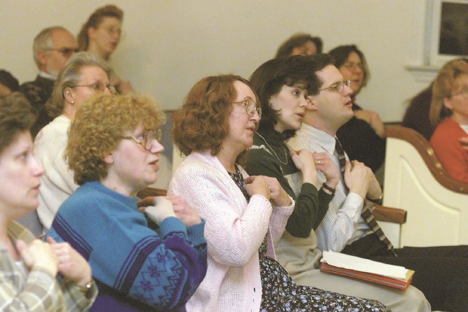RJ file photo - Parishioners at Central Baptist Church in Southington, from left, Suzanne McKirdy, Clair Lemanski, Arlene Bubar and Cindy and Dave Crichton, during a sign language class being taught by Dr. Eugene Kimmel March 9, 1999.