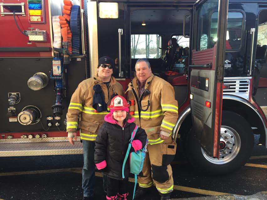 Pictured: Captain Mike Blais and Lieutenant Matt Pepe from the South Kensington Fire Department and Griswold student Harlee. She won a ride on a fire truck to school, Thursday, March 16. |Mike Blais, Contributed