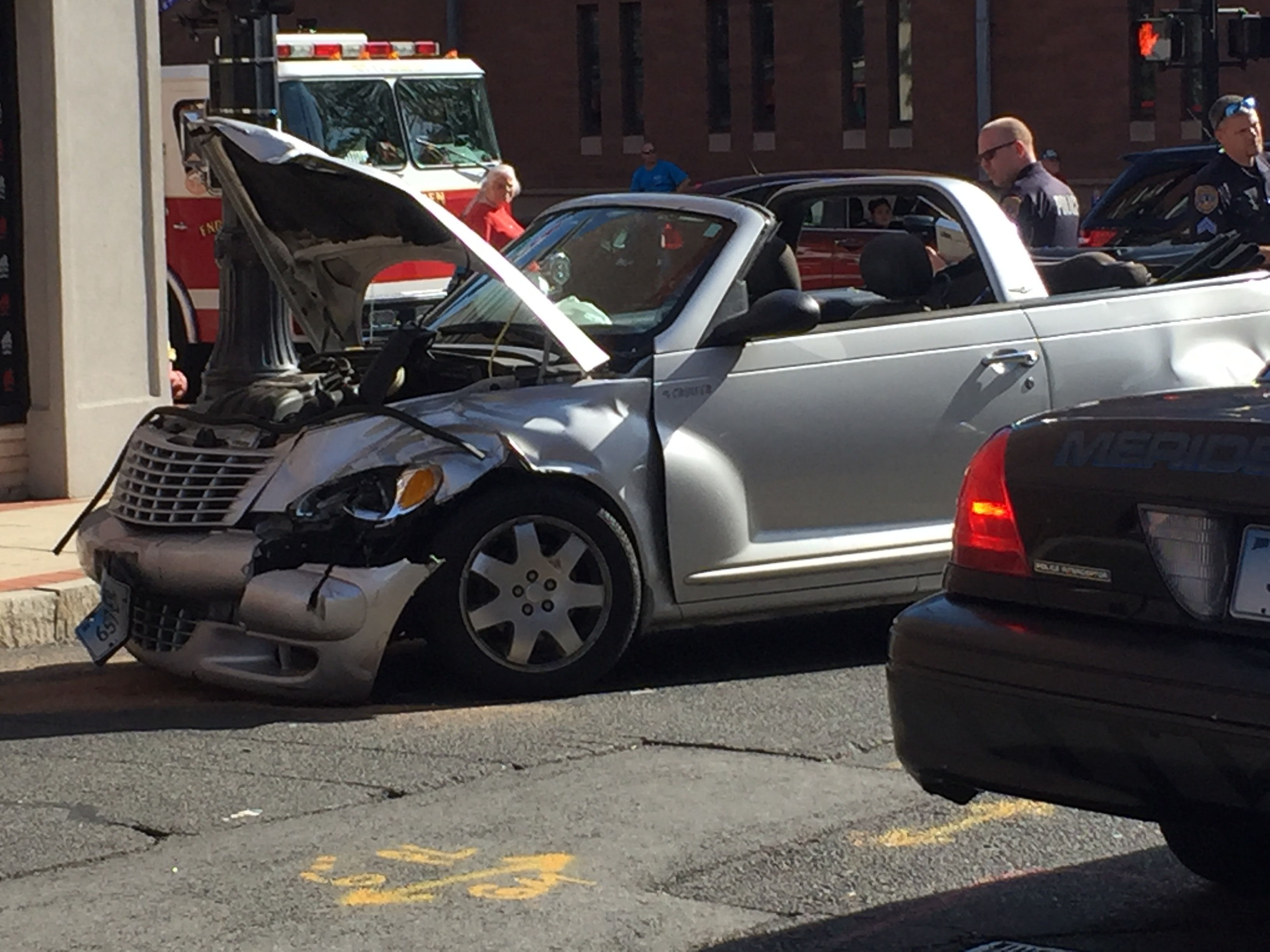 A two-car accident occured Saturday afternoon at the intersection of West Main Street and Grove Street in Meriden. | Matthew Zabierek, Record-Journal
