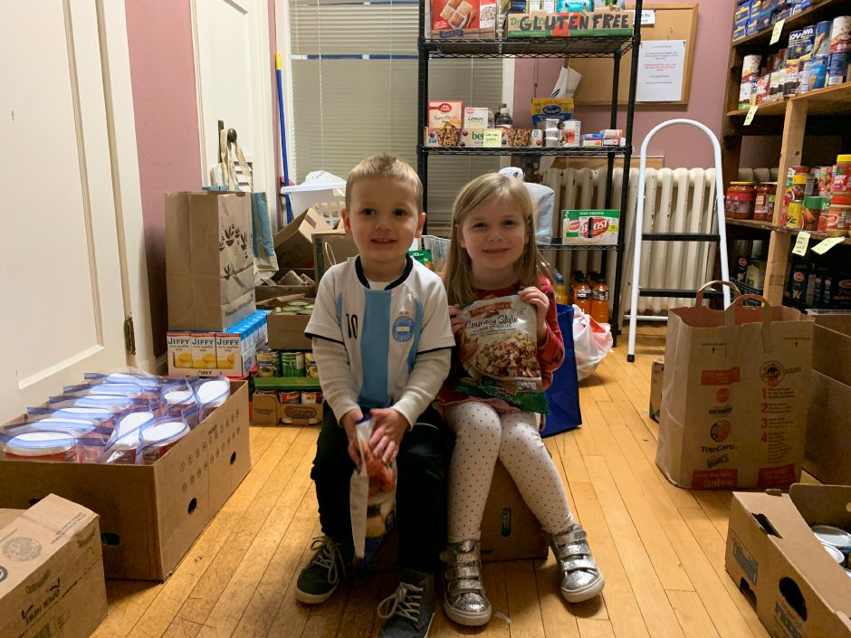 3-year-old Brian and 5-year-old Leah Checko worked to collect hundreds of food items for those in need this holiday season. Photo by Everett Bishop, Town Times