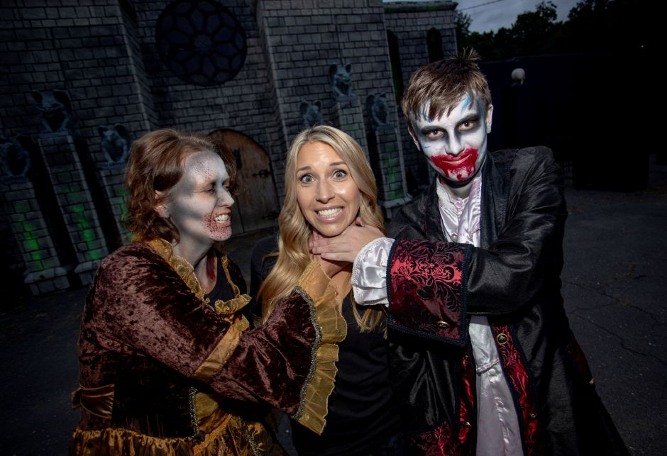 Makeup artist Christina Klanahich, center, with two of her creations, Kathy Hall, left, and Ethan Hall, right, at the Haunted Graveyard at Lake Compounce Sept. 27, 2018. | Richie Rathsack, Record-Journal