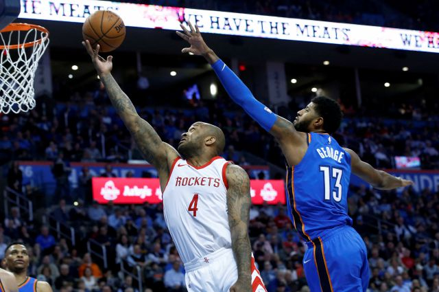 Houston Rockets forward P.J. Tucker (4) shoots in front of Oklahoma City Thunder forward Paul George (13) in the first half of an NBA basketball game in Oklahoma City, Tuesday, March 6, 2018. (AP Photo/Sue Ogrocki)