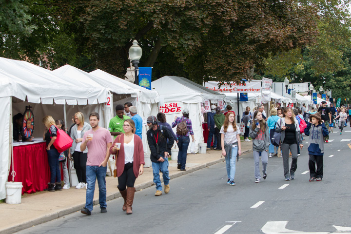 Vendors line Main Street in Southington Saturday for the 48th Annual Apple Harvest Festival in downtown Southington Oct. 8, 2016 | Justin Weekes / For the Record-Journal