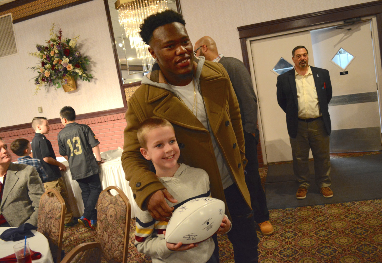 New England Patriots cornerback Cyrus Jones poses with Ryan Plouffe at the United Way 2017 NFL Players Weekend dinner on Friday, March 10, 2017. | Bryan Lipiner, Record-Journal