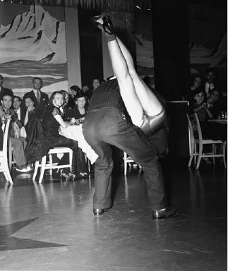 Jitterbugs flung themselves all over the dance floor of  Wardman Park hotel on night, Sept.21,1939 of in the semifinals of a citywide contest in Washington, D.C.   Fashionable clients of the supper dance got this view of Katherine deThierry and Hop Perrell swinging it.(AP Photo)