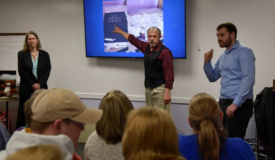 Three principals members of The Eastern Connecticut Paranormal Society, Melissa Whited, Chris O'Connor, and David Bray, present findings from paranormal investigations during an event at the Southington Public Library on Wednesday, April 18. | Bailey Wright, Record-Journal