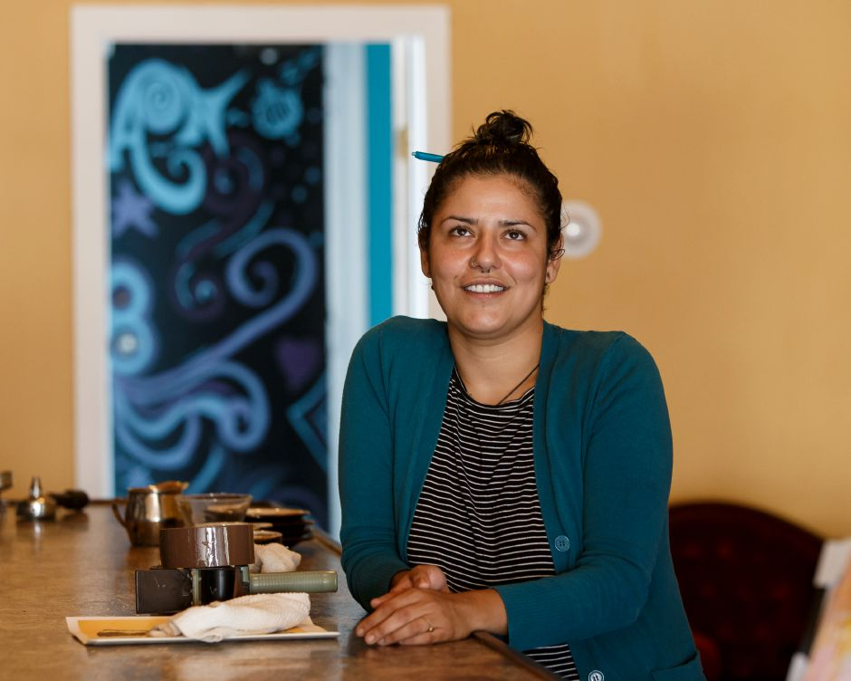 Sarah Sharif stand in the cafe section of the restaurant Wednesday at Arles and Boggs Vegan Eatery in Wallingford October 10, 2018 | Justin Weekes / Special to the Record-Journal