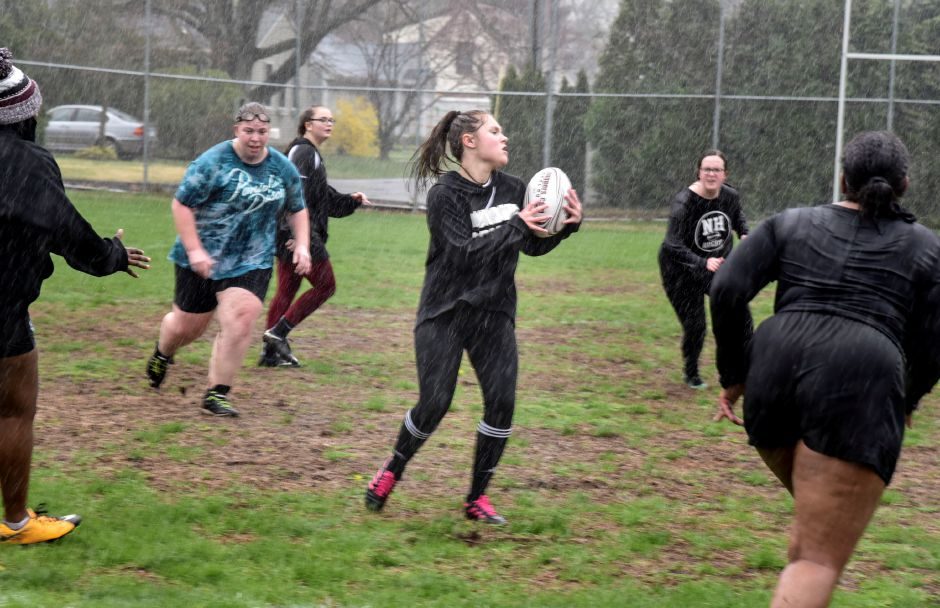 Sophomore Olivia Scoppetto with the ball during a North Haven Girls Rugby team practice at the athletic complex on April 22, 2019. Their next game is May 2, 4:30 p.m. at the athletic complex. | Bailey Wright, North Haven Citizen