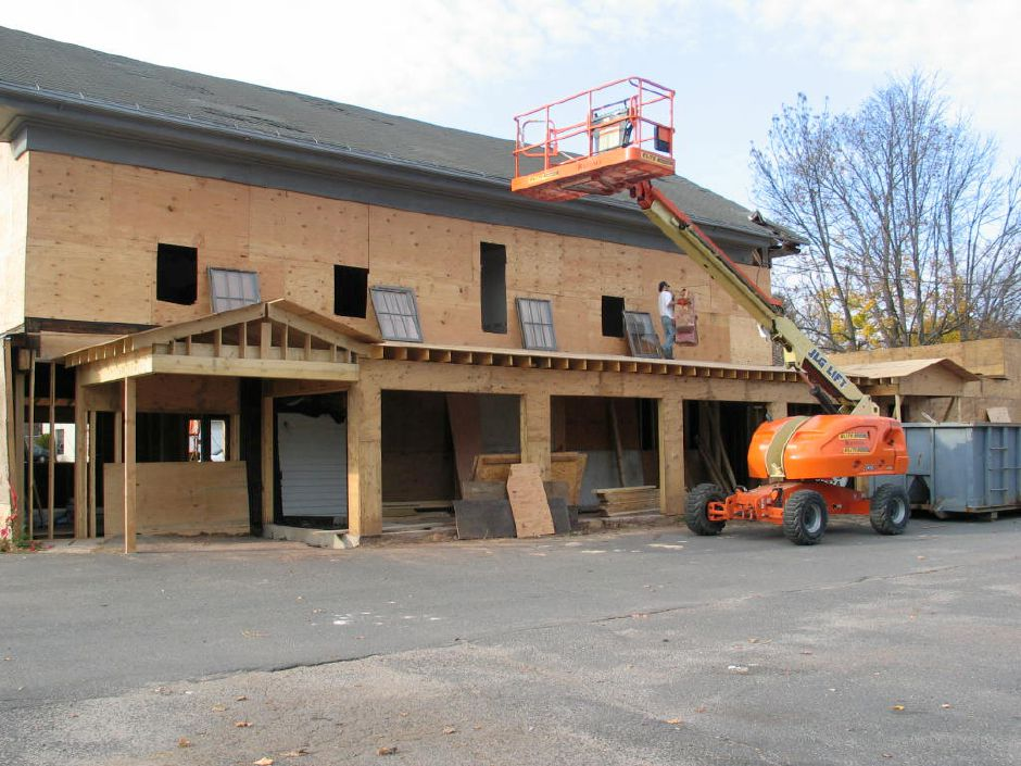 Workers work on the building that will become Zingarella, a pizza restaurant, in downtown Plantsville, Oct. 3, 2009. The building is the former home of Krys