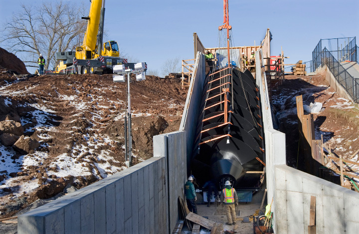 Crews help position a 20-ton, 35-foot-long metal screw into place at Hanover Dam in South Meriden, Tuesday, December 20, 2016. The Archimedes screw, named for the ancient Greek scientist credited with its invention, is the first of its kind installed in the U.S.  | Dave Zajac, Record-Journal