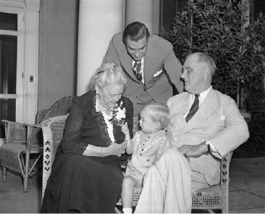 Representatives of four generations of Roosevelts at the Roosevelt home in Hyde Park, N.Y., on Sept. 21, 1940, during the observance of the 86th birthday of Mrs. Sara Delano Roosevelt (left), mother of President Franklin D. Roosevelt. Three Franklin Delano Roosevelts, the president (right), his son (behind) and his son (center), were at the informal party, featured by a cake with 21 candles, a limitation set by the Roosevelt's years ago. (AP Photo/Charles Gorry)