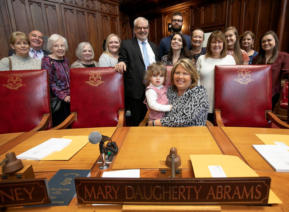 Senator Mary Daugherty Abrams, surrounded by family, holds grandaughter Rose Thomas, 2, during opening day of the legislative session Jan. 9, 2019. | Dave Zajac, Record-Journal
