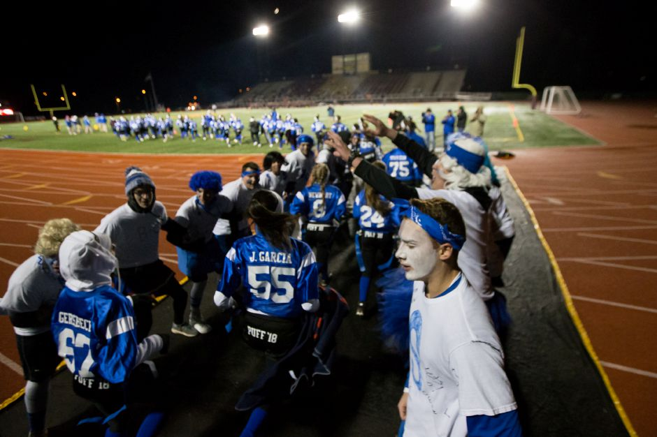 The Lady Knights take the field Wednesday during the 9th Annual Powder Puff football game at Veterans Memorial Stadium in New Britain. Southington defeated New Britain 20 to 0 to make it two wins in a row. November 22, 2017 | Justin Weekes / For the Record-Journal