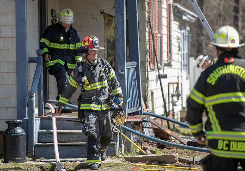 Southington firefighters exit the first floor after putting out a fire at 764 Marion Ave. in Southington, Monday, April 1, 2019. Dave Zajac, Record-Journal