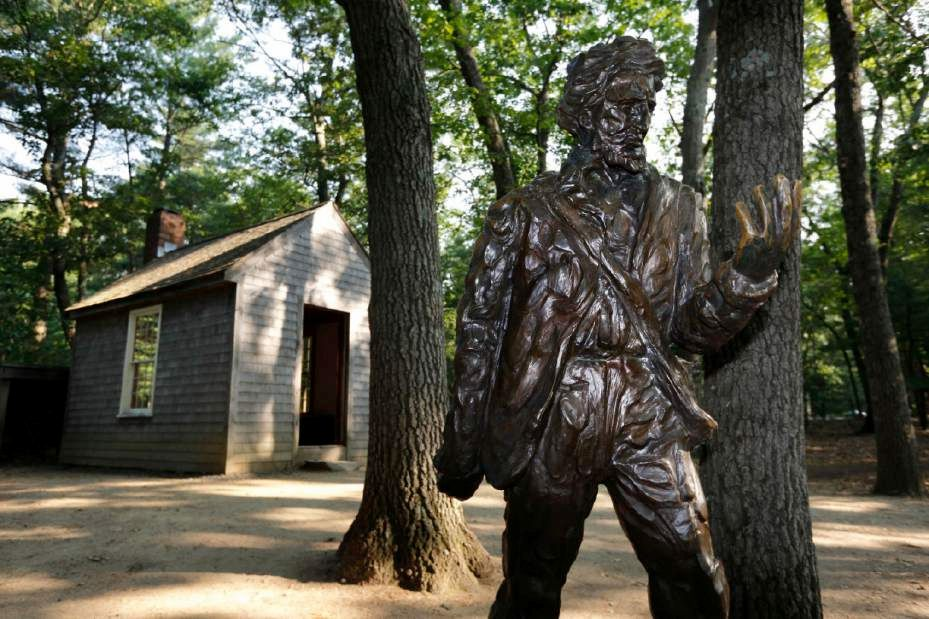 FILE - In this July 13, 2012 file photo, a statue of Henry David Thoreau stands outside a replica of his cabin near the shores of Walden Pond in Concord, Mass. Two centuries after Thoreau