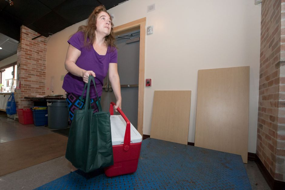 Melissa Keefe weighs food from Dag Hammarskjold Middle School before sorting it Friday at Master