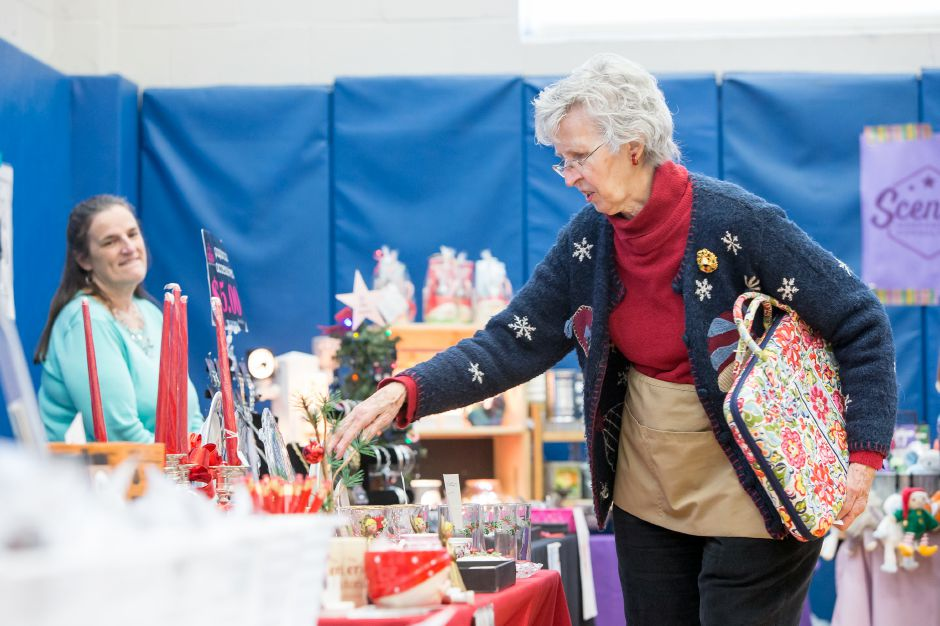 Chris Ruel of Meriden stops to look at the Meriden Historical Society inside the Hanover Elementary School Saturday during Christmas in the Village on Main Street in South Meriden December 1, 2018 | Justin Weekes / Special to the Record-Journal