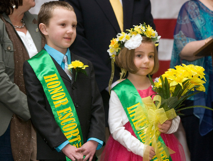 Little Miss Daffodil, Alexandra Gaj, 5, and her honor escort, Kyler Patterson, 6, stand together on stage moments after the annual crowning ceremony at Hubbard Park in Meriden, Wednesday, April 23, 2014. Gaj is a student at Ben Frankilin Elementary School and Patterson attends John Barry Elementary School.   |  Dave Zajac / Record-Journal