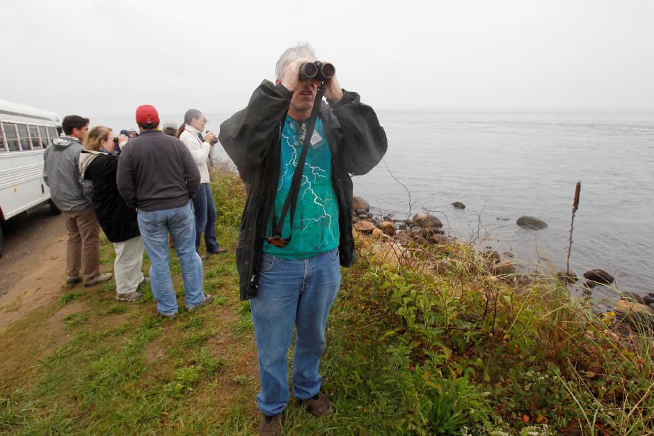 A group of people, primarily environmentalists and ecologists, tour Plum Island in Plum Island, Wednesday, Oct. 6, 2010. (AP Photo/Seth Wenig)