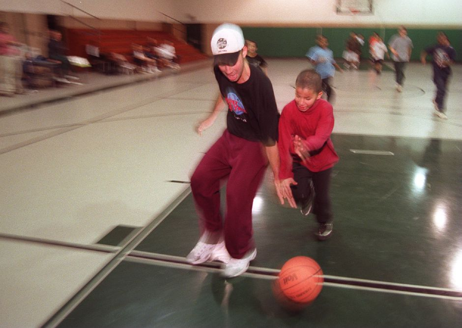 RJ file photo - Danny Oquendo plays basketball at the Meriden Boys Club, May 1999.